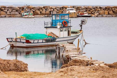 troy: Fishing boat on an inlet of the Aegean Sea near Troy in Turkey Stock Photo
