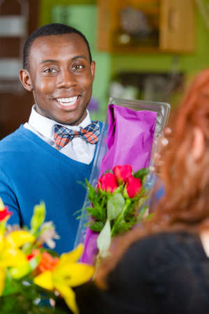 dapper: Dapper man purchasing roses at a florist shop Stock Photo