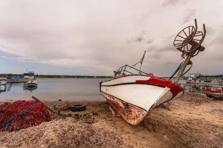 troy: Fishing boat on beach seaside near Troy in Turkey