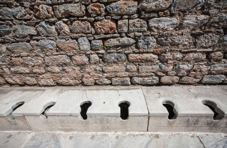 communal: Ancient communal toilets from bath house in Turkey