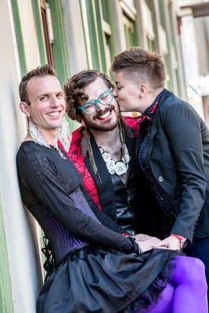dapper: Friendly kiss in a young gender fluid trio