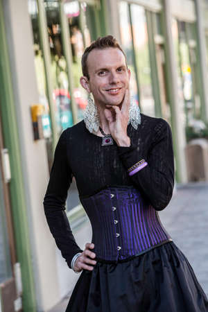 trans gender: Gender fluid young man in corset and skirt