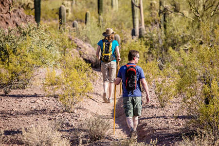Couple rugged desert hiking in the American Southwest