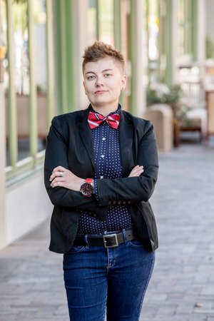 dapper: Serious dapper young gender fluid woman with arms crossed