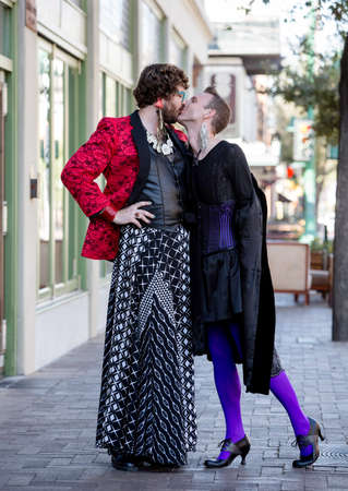 flamboyant: Handsome gender fluid young men in flamboyant drag kissing