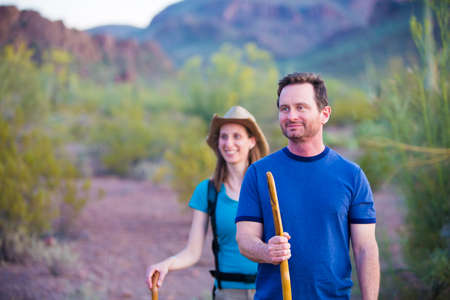 southwest: Couple desert hiking near mountains in the American Southwest