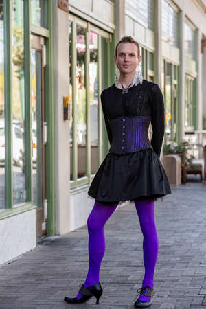 trans gender: Gender fluid young man in corset and high heels