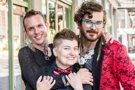 trans gender: Happy gender fluid trio of young friends Stock Photo