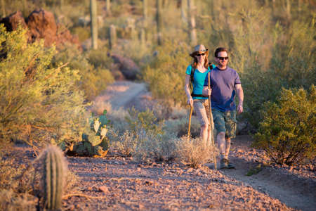 southwest: Two afternoon desert hikers in the American Southwest Stock Photo