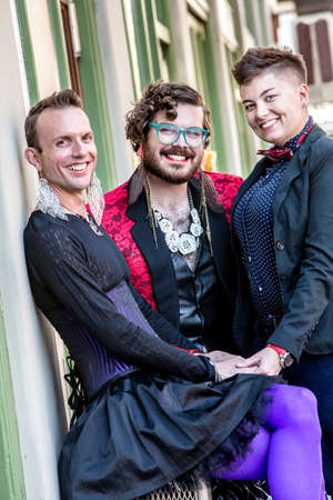 trio: Smiling gender fluid trio of young friends Stock Photo