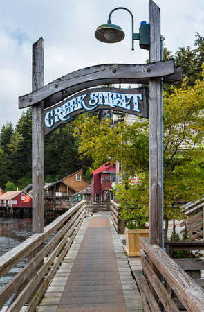 brothel: KETCHIKAN, AK - MAY 15: Entry sign to walkway and historic buildings on Creek Street on May 15, 2016 in Ketchikan, AK.