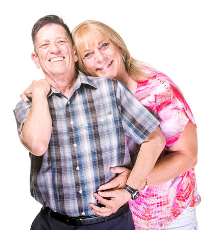 close together: Smiling transgender man and woman isolated on white background posing close together