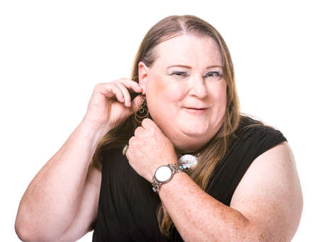 transgender: Closeup of transgender woman adjusting earring on white background Stock Photo
