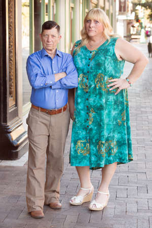 transgender: Transgender couple with folded and crossed arms standing together