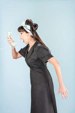 caller: Screaming retro woman in black dress with vintage phone receiver