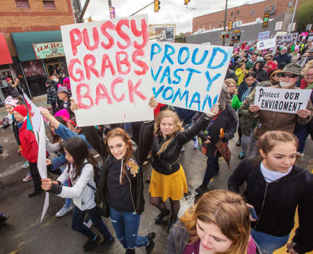 dissent: TUCSON, AZ - JANUARY 21: High angle view of various protestors holding signs as they walk at the Womens March on Washington January 21, 2017 in Tucson, AZ, USA.