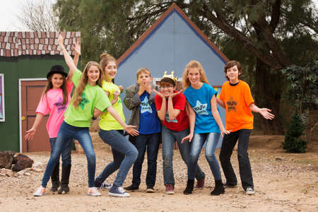 Child actors at camp pose and act silly for the camera Stockfoto