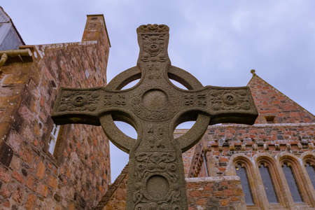 Saint Johns Cross in front of historic Iona Abbey