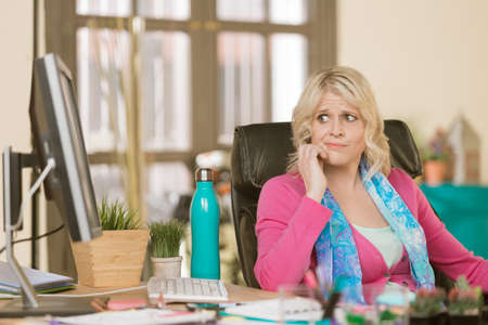 Worried professional woman in her office Standard-Bild - 120888118