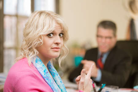 Woman gesture towards incompetent male colleague Standard-Bild - 120888252