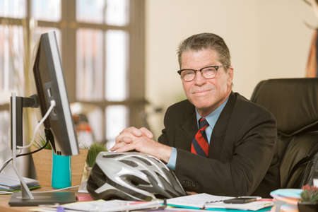 Handsome professional man with a bicycle helmet Standard-Bild - 120888017