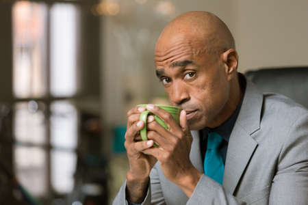 Stylish professional man with coffee or tea Stok Fotoğraf
