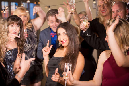 Beautiful dark haired woman dancing at a party or reception Standard-Bild - 120888021