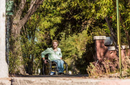 Young man in wheelchair Standard-Bild - 120888023