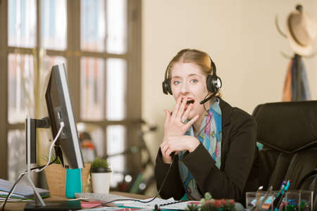 Shocked young professional woman on a headset call Standard-Bild - 120888028