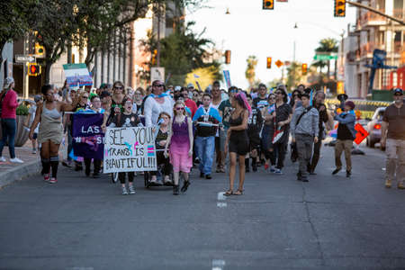 TUCSON, UNITED STATES  - March 29: Unidentified marchers walking and holding  signs in support of trans people at a visibility rally. March 29, 2019 in Tucson, Arizona, USA. Standard-Bild - 120916252