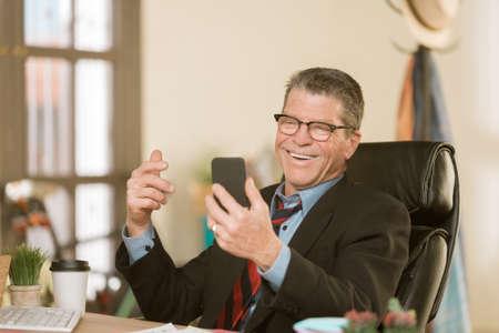 Cheerful man communicating using smart phone