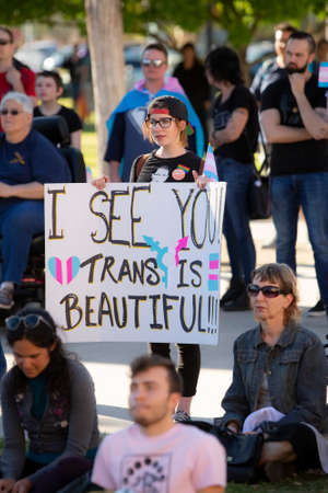 TUCSON, UNITED STATES  - March 29: Unidentified person holding a sign in support of trans people at a visibility rally. March 29, 2019 in Tucson, Arizona, USA. Standard-Bild - 120916250