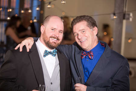 Two handsome friends wearing bow ties at a party Standard-Bild - 120887800