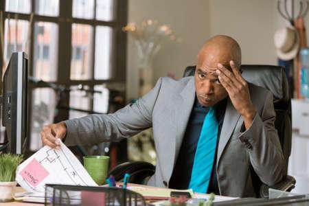 Stressed professional man in his office Standard-Bild - 120887804