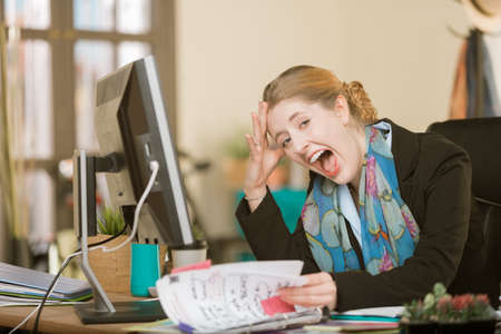 Overworked creative professional woman screaming Standard-Bild - 122101259