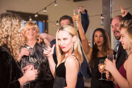 Funny mature woman at a party or reception Standard-Bild - 122101262