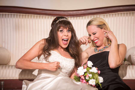 Friend with screaming bride at a wedding reception Standard-Bild - 122101269
