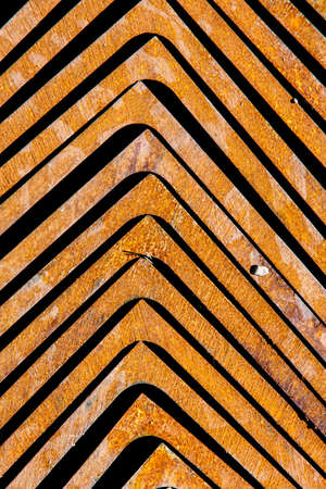 Rusty stacked metal brackets pointing towards top of frame Reklamní fotografie