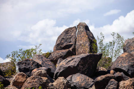 Hohokam era petroglyphs on boulders in the Arizona Desert Stock Photo