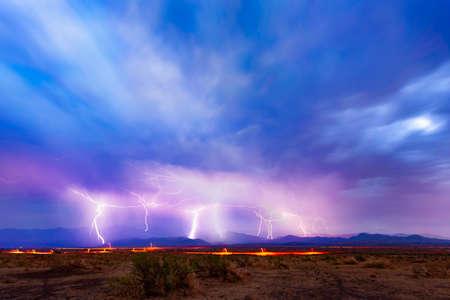 Multiple lightning strikes on a distant horizon