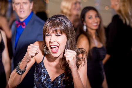 Frustrated mature woman screaming at a party Banco de Imagens