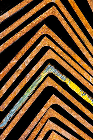 Rusty metal brackets pointing towards top of frame Banco de Imagens