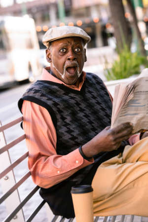 Man downtown with newspaper reacts to story