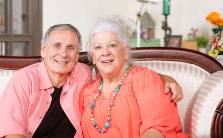 Senior man and woman at home smiling
