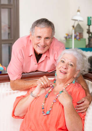 Cheerful senior man and woman at home smiling Foto de archivo