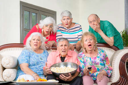 Six unhappy senior friends reacting to television