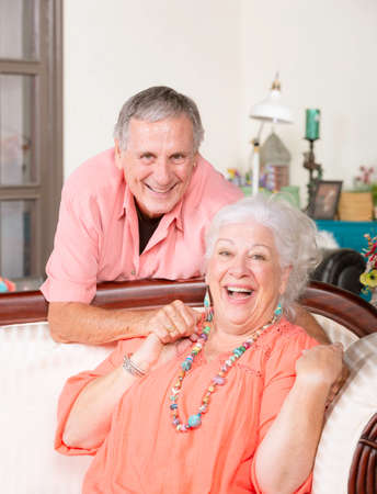 Affectionate senior man and woman at home