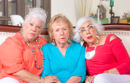 Three skeptical or shocked senior women