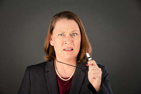 Angry female corporate or government whistleblower ready to blow