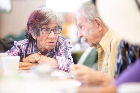 Friends talking in a senior activity center